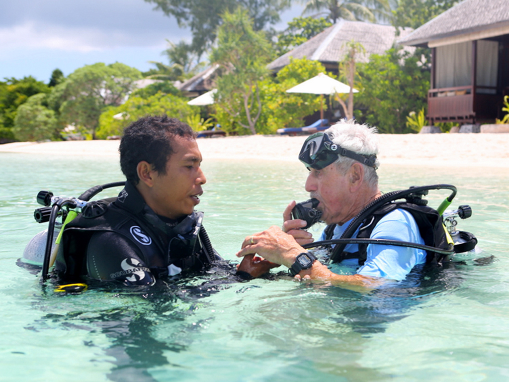 Komang and Herb prepare for the dive. photo Wakatobi Dive Resort