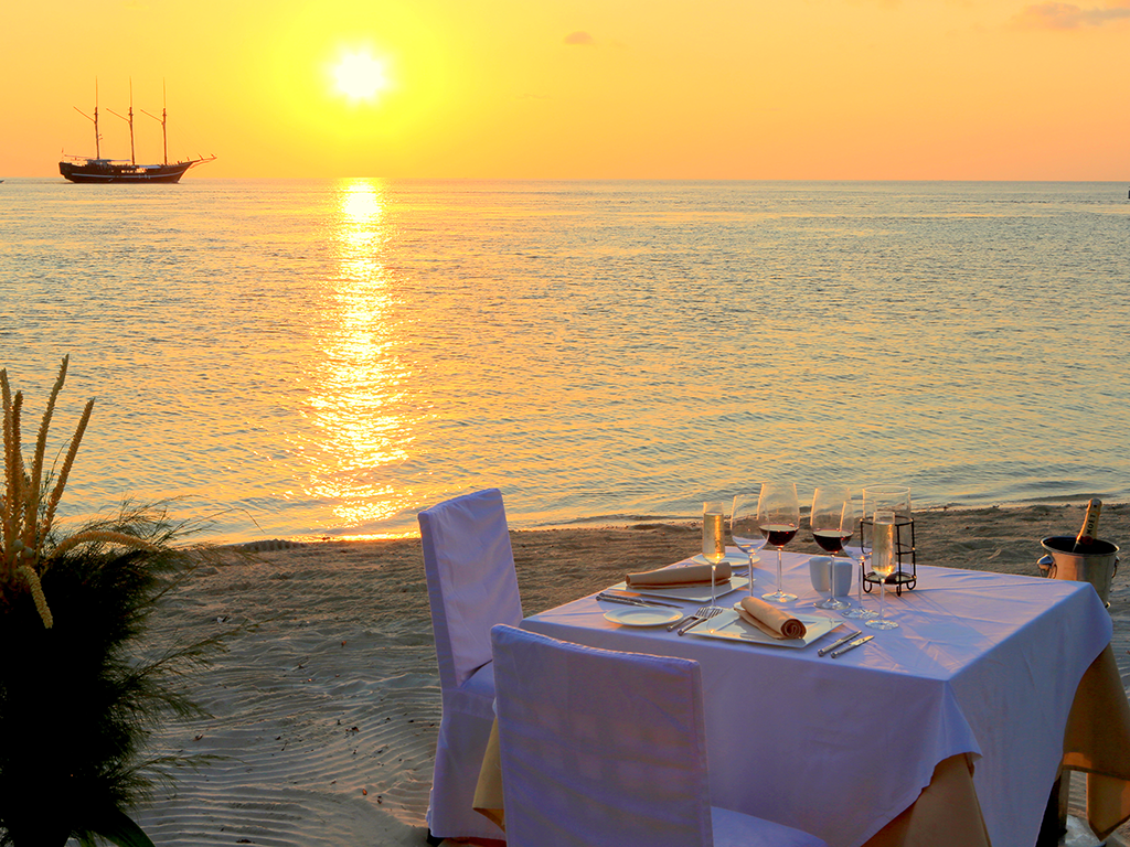 Sunset dining on the beach is romantic and peaceful. photo Wakatobi Dive Resort