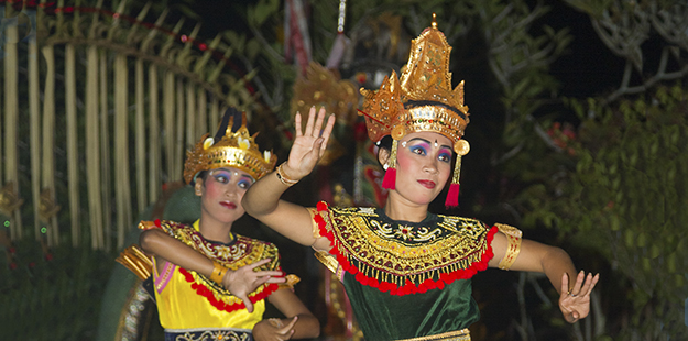 New Years is a particularly festive time at Wakatobi when resort staff and local residents share their traditions with guests, such as dancing in brilliant costumes. Photo by Walt Stearns