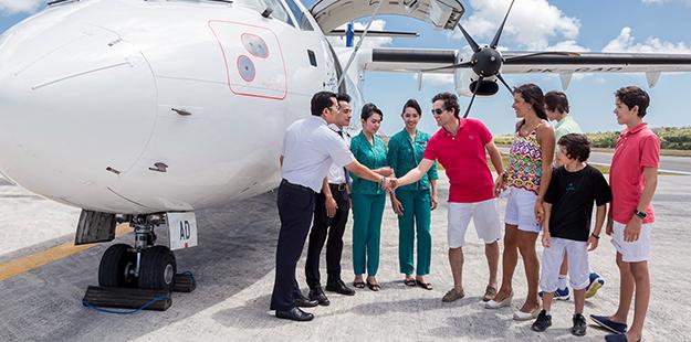 The Garuda Indonesia flight crew take great pride in providing a unique brand of service exclusive to Wakatobi guests. Photo by Wakatobi Resort