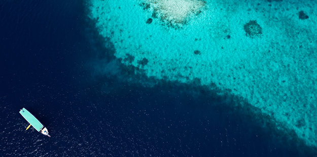 wakatobi-resort-boat-on-coral-reef