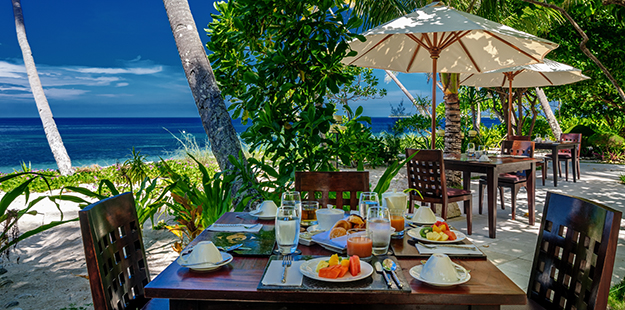 You may find starfruit on the breakfast table at Wakatobi, accompanied by a stunning ocean view.