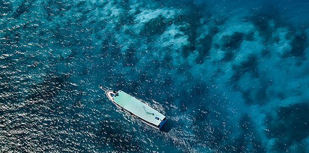 On the way to Roma you'll cruise along a colorful reef line that transitions from the shallows to deep blue water. Photo by Didi Lotze
