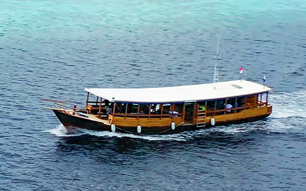 Wakatobi's large, custom-built boats provide full shade and plenty of room to spread out and relax.