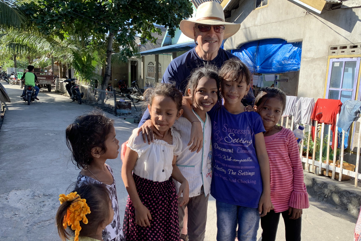 """Guest Steve Lyons has fond memories of visiting Lamanggau and especially the """"sweet, smiling faces of the Indonesian children."""""""